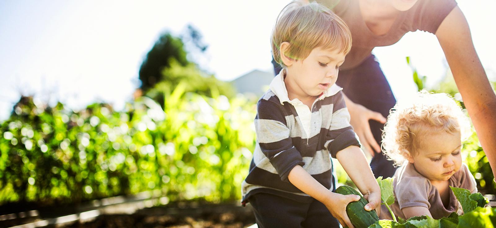 children helping mom with gardening