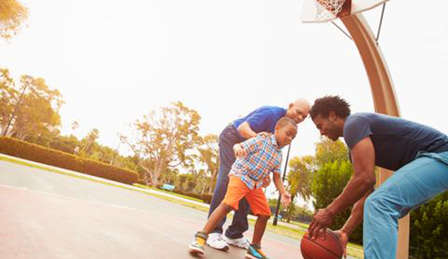 Man playing basketball with child