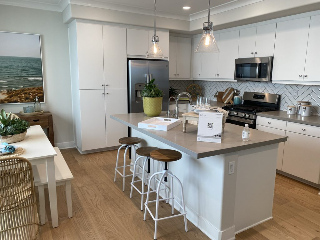 delia kitchen with island and bar stools